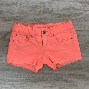 American Eagle Neon Orange Frayed Shorts